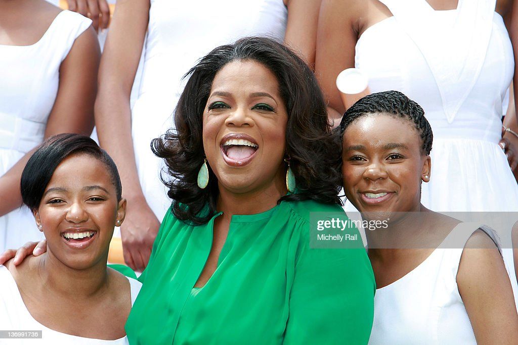 Oprah Winfrey poses with the Graduates on her arrival at the inaugural graduation of the class of 2011 at Oprah Winfrey Leadership Academy for Girls on January 14, 2012 in Henley on Klip, South Africa.