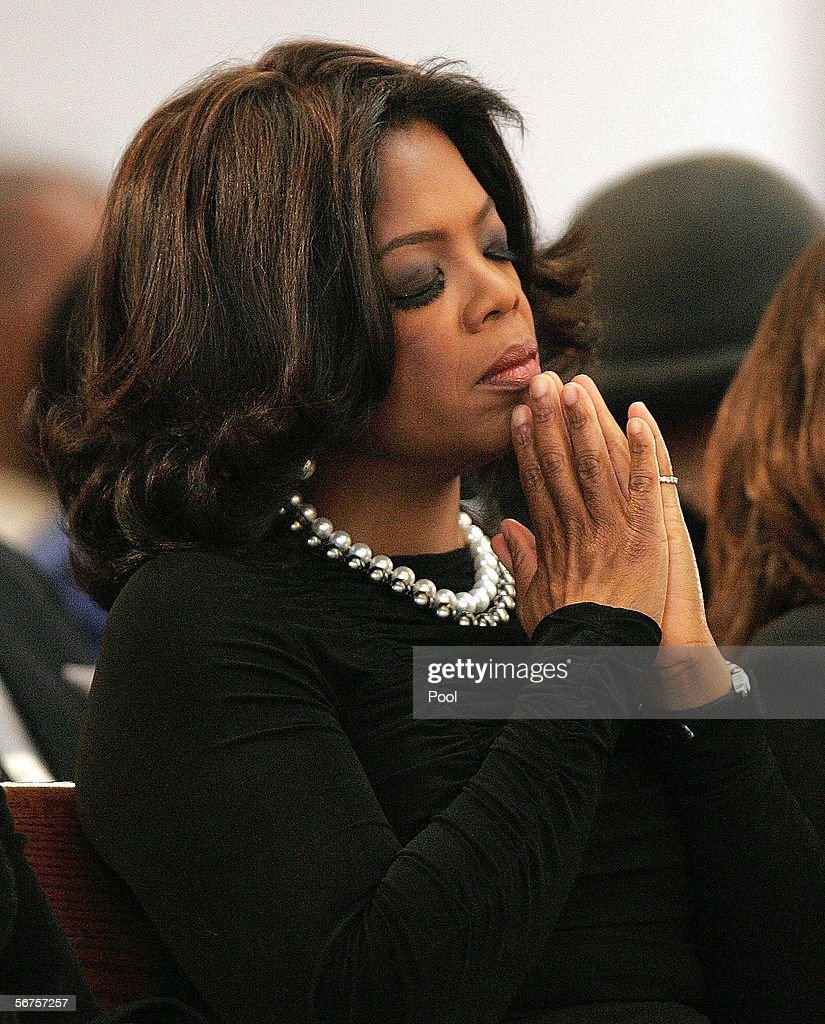 Oprah Winfrey reacts during a musical tribute to Coretta Scott King at the new Ebenezer Church February 6, 2006 in Atlanta, Georgia. King's casket will lie in Ebenezer Baptist Church, where her husband the Rev. Martin Luther King Jr. preached in the 1960s and the civil rights matriarch remained a member until her death. King died January 31 in Mexico at an alternative medicine clinic, where doctors said she was battling advanced ovarian cancer.