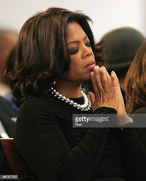 Oprah Winfrey reacts during a musical tribute to Coretta Scott King at the new Ebenezer Church February 6 2006 in Atlanta Georgia King's casket will...