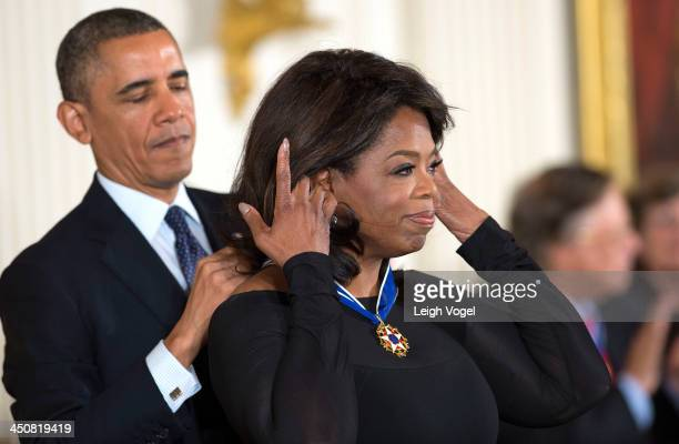 Oprah Winfrey receives the 2013 Presidential Medal of Freedom presented by President Barack Obama in the East Room of the White House on November 20...