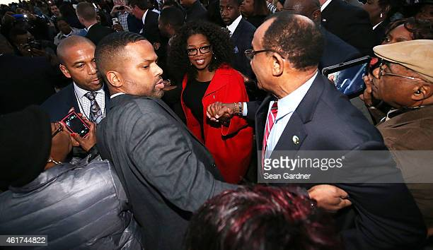 Oprah Winfrey shakes hands with Mayor Patrick Evans of Selma as members of the cast of the movie Selma walk down Broad St towards the Edmund Pettus...
