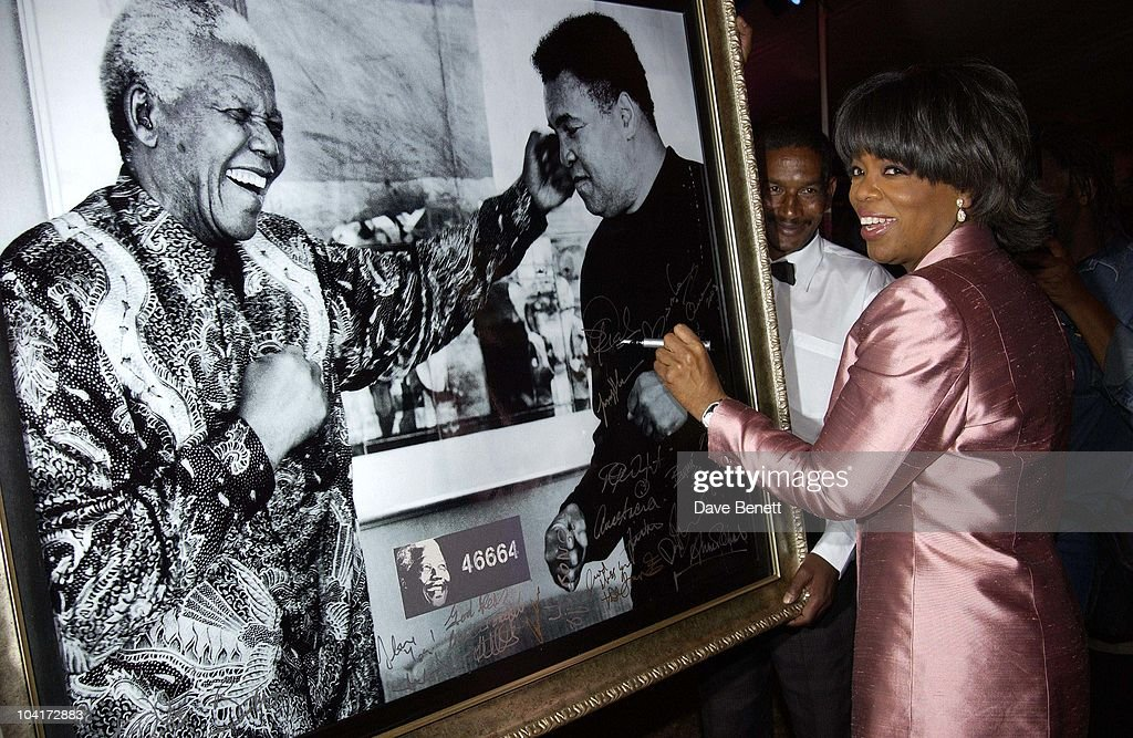 Oprah Winfrey Signs A Print Of Nelson Mandela And Mohammad Ali That Was Auctioned, The Stars Of Rock And Roll Join Forces For Nelson Mandela's 46664 Concert In Cape Town, South Africa. In The Pre, Concert Build Up, This Evening A Gala Dinner Was Held At The Vergelegen Estate Outside Cape Town, South Africa Gears Up For Aids Awareness Mandela Concert 46664. The Concert Is In Association With Mtv's Staying Alive & Www.46664.com Powered By Tiscali.