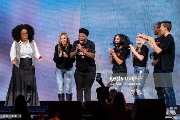 Oprah Winfrey speaks with the stars of Netflix's Cheers Monica Aldama Jerry Harris Gaby Butter Lexi Brumback TT Baker and Dillion Brandt during...
