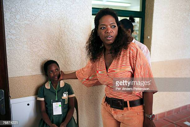 Oprah Winfrey touches one of the girls that she interviewed for her school for unprivileged girls on August 12 2006 in Durban South Africa Oprah has...