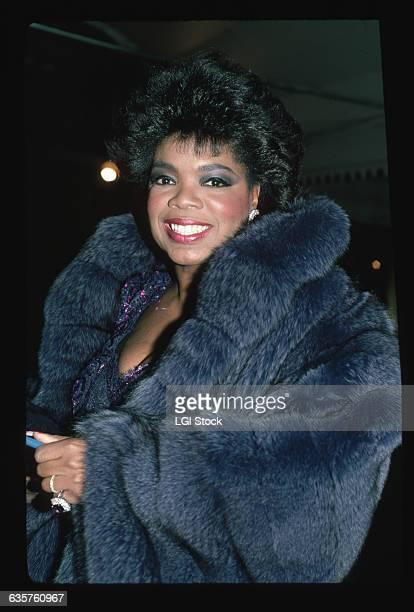 1987 Oprah Winfrey waistup wearing a fur coat
