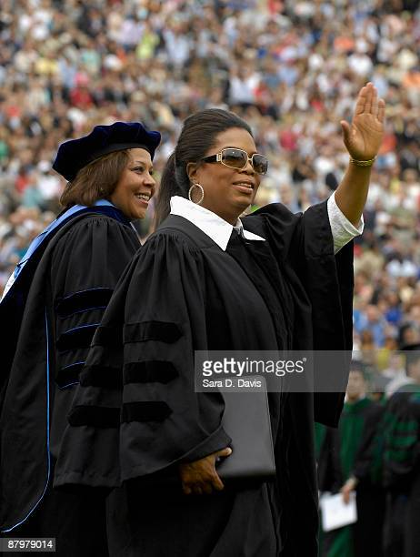 Oprah Winfrey waves to the crowd as she enters Wallace Wade Stadium at Duke University on May 10 2009 in Durham North Carolina Winfrey was the 2009...