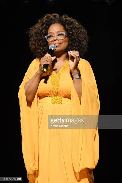 Oprah Winfrey wearing GertJohan Coetzee speaks on stage during the Global Citizen Festival Mandela 100 at FNB Stadium on December 2 2018 in...