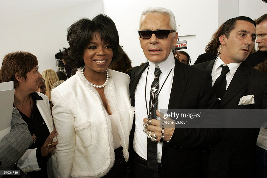 Oprah Winfrey with Karl Lagerfeld attend the Chanel Spring/Summer 2005 Fashion Show during Paris Fashion Week on July 7, 2004 in Paris, France.