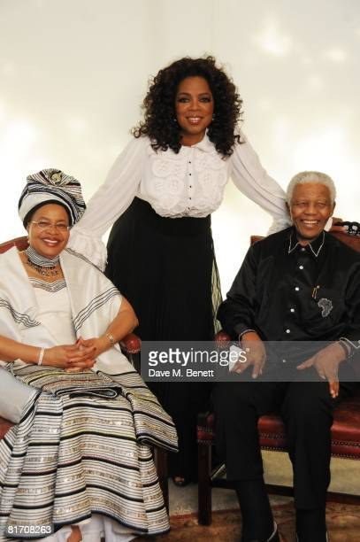 Oprah Winfrey with Nelson Mandela and his wife Graca Machel attend the dinner in honour of Nelson Mandela celebrating his 90th birthday at Hyde Park...
