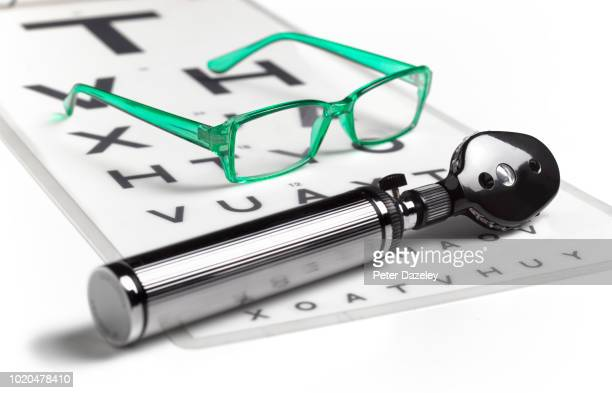 opthalmoscope and glasses on sight test chart - eye chart stock pictures, royalty-free photos & images