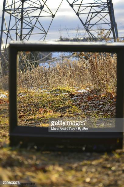 Optical Illusion Of Field Seen Through Damaged Television Set