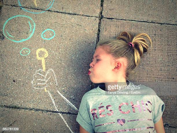 Optical Illusion Of Girl Blowing Bubbles On Street