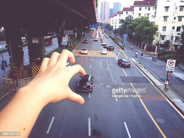optical illusion of hand picking car from road - optical illusion stock photos and pictures