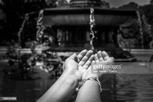 Optical Illusion Of Hands Taking Water From Fountain