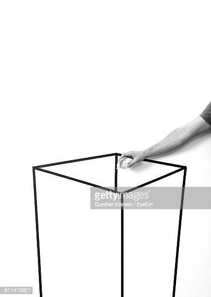 Optical Illusion Of Man Throwing Garbage In Drawn Container On Paper