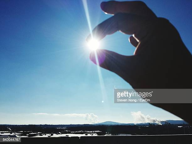 Optical Illusion Of Person Holding Sun