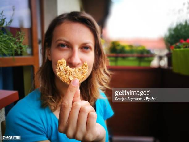 Optical Illusion Of Woman With Oatmeal Cookie Smile At Restaurant