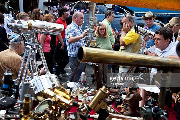 Optical instruments stall on Portobello Road market Notting Hill West London This famous Sunday market is when the antique stalls come out as well as...