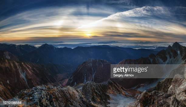optical phenomenon of halo over highland valley in japan - light natural phenomenon stock photos and pictures