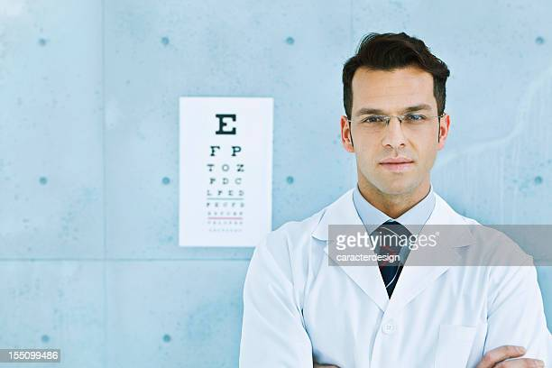 Optician in front of an eye chart
