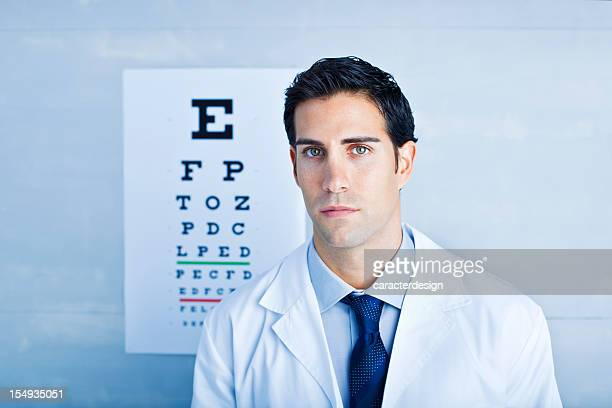 Optician in front of eye chart