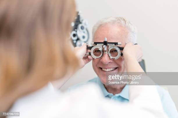 Optician testing mans eyesight