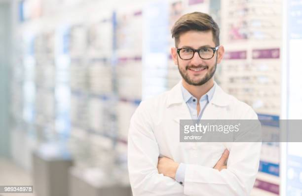 optician wearing glasses at the optical shop - optometry stock pictures, royalty-free photos & images