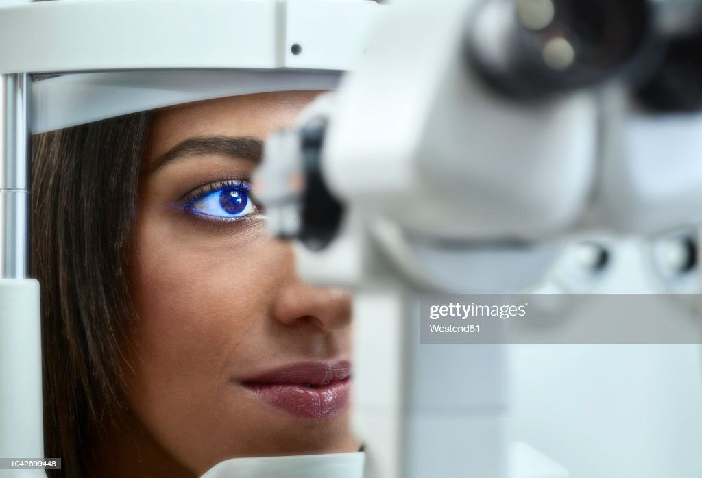 23bb467bf393 Optician Young Woman During Eye Test Stock Photo