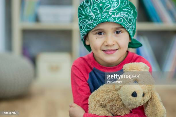 optimism - bald girl stock photos and pictures