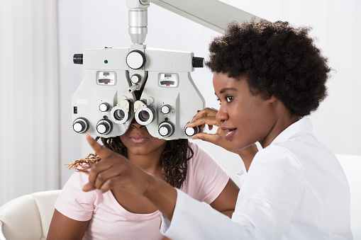Optometrist Doing Sight Testing For Patient 909309810
