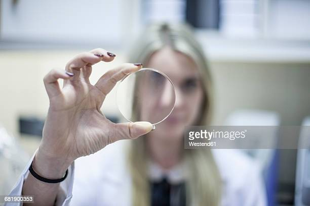 optometrist looking through eydeglass lens - lens eye stock photos and pictures