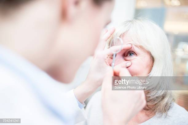 Optometrist with magnifying glass