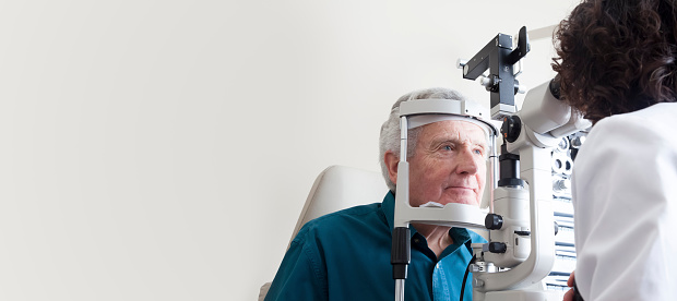 Optometrist with patient 532317293