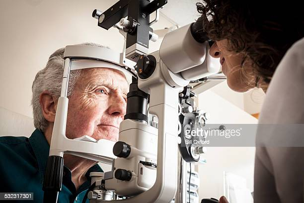 optometrist with patient - optometry stock pictures, royalty-free photos & images