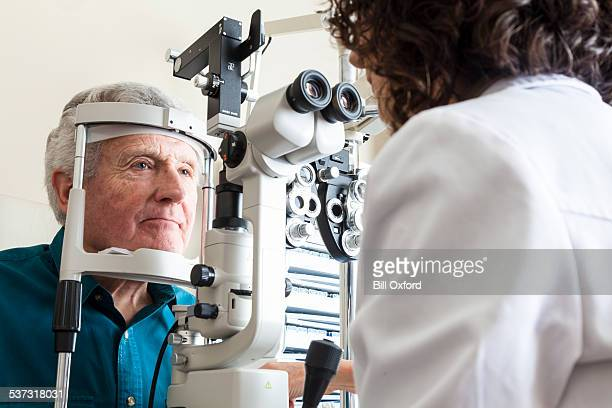 Optometrist with senior patient