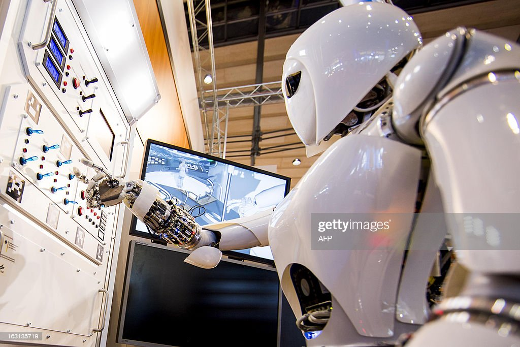 AILA, or Artificial Intelligence Lightweight Android, presses switches on a panel it recognizes during a demonstration at the German Research Center for Artificial Intelligence GmbH (Deutsches Forschungszentrum fuer Kuenstliche Intelligenz GmbH) stand at the 2013 CeBIT technology trade fair on March 5, 2013 in Hanover, Germany. CeBIT will be open March 5-9.
