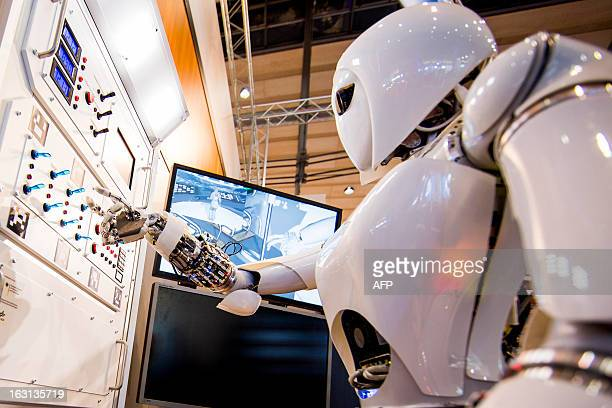 AILA or Artificial Intelligence Lightweight Android presses switches on a panel it recognizes during a demonstration at the German Research Center...