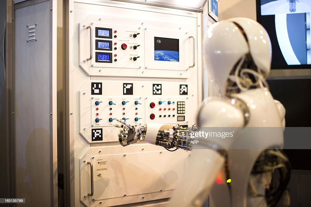 AILA, or Artificial Intelligence Lightweight Android, presses switches on a panel it recognizes during a demonstration at the German Research Center for Artificial Intelligence GmbH (Deutsches Fors...