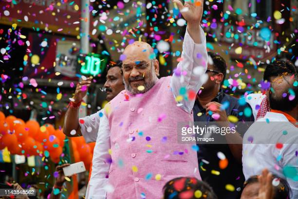 BJP or Bharatiya Janata Party national president Amit Shah seen waving to his supporters during the Show in Kolkata Bharatiya Janata Party president...