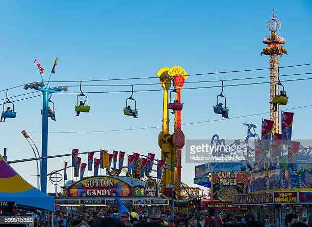 CNE or Canada National Exhibition General view of amusement ridesfood stands and public
