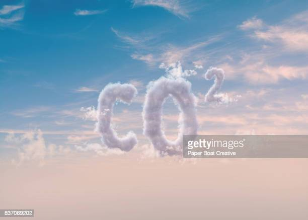 co2 or carbon dioxide digitally edited to look as if it was guised from the clouds and sky - typographies stock photos and pictures