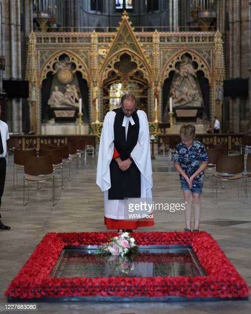 Or COLOURABLY SIMILAR. Reverend Anthony Ball, Canon of Westminster in Westminster Abbey in London with Toby Wright, son of the Reverend Paul Wright,...