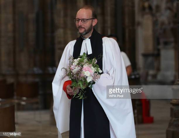 Or COLOURABLY SIMILAR. Reverend Anthony Ball, Canon of Westminster in Westminster Abbey in London with Princess Beatrice's wedding bouquet which,...