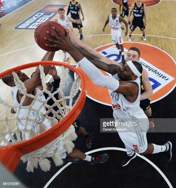 Or Fischer of Bamberg and Sharrod Ford of Bamberg block during the Beko BBL Top Four semifinal match between Alba Berlin and Brose Baskets at...