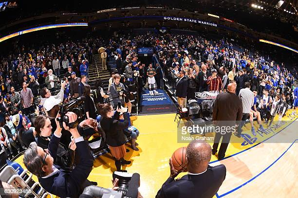 Oracle Arena Security Guard Curtis Jones gets ready to toss a ball to Stephen Curry of the Golden State Warriors before the game as part of a pregame...