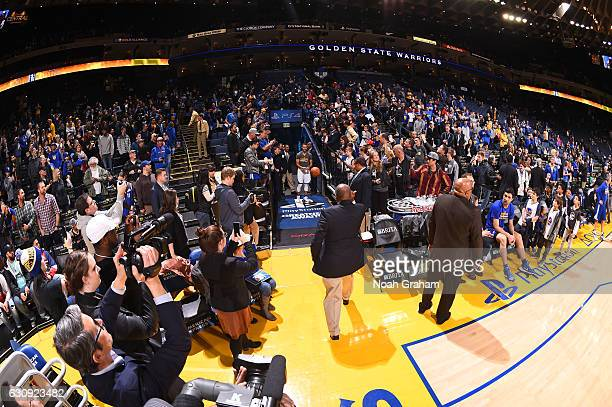 Oracle Arena Security Guard Curtis Jones tosses a ball to Stephen Curry of the Golden State Warriors before the game as part of a pregame ritual...