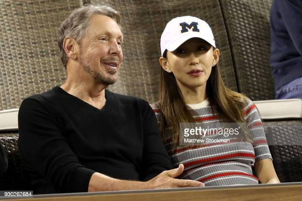 Oracle Cofounder Larry Ellison watch Roger Federer of Switzerland play Federico Delbonis of Argentina during the BNP Paribas Open at the Indian Wells...
