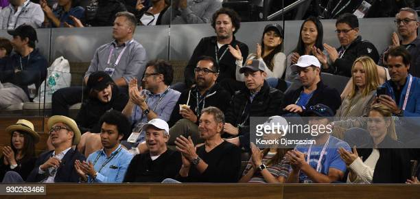 Oracle Cofounder Larry Ellison watches Roger Federer of Switzerland play Federico Delbonis of Argentina during Day 6 of the BNP Paribas Open on March...