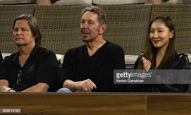 Oracle Cofounder Larry Ellison watches the tennis match between Ryan Harrison of United States and Frederico Delbonis of Argentina during Day 4 of...