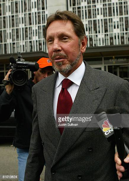 Oracle Corp CEO Larry Ellison is questioned by reporters as he leaves the federal courthouse June 30 2004 in San Francisco Ellison testified in the...